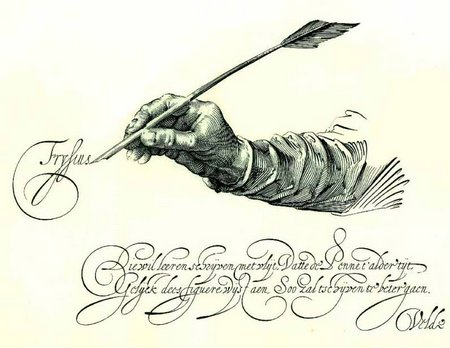 Quill in hand writing calligraphy