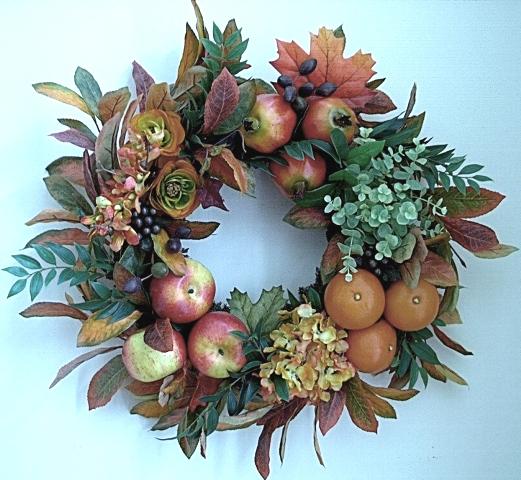 fake fruit and flower wreath