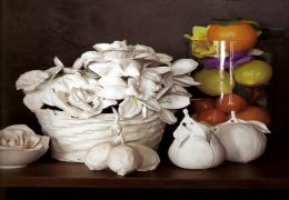 Plaster-dipped silk flowers and plastic fruit